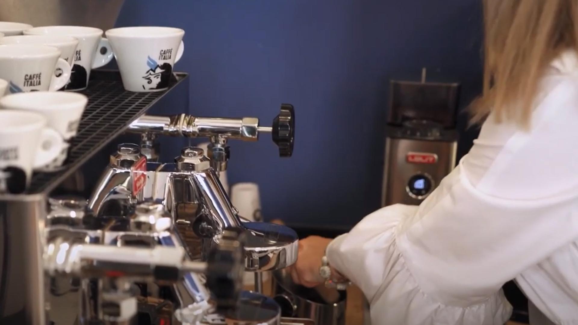 A female barista preparing coffee in a bar in North Macedonia